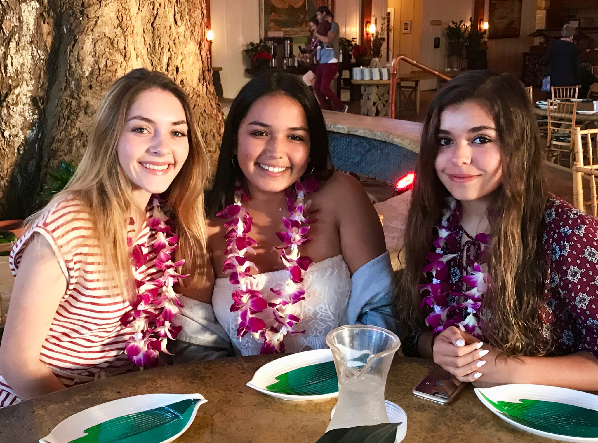 looking pretty with their flower leis at the luau