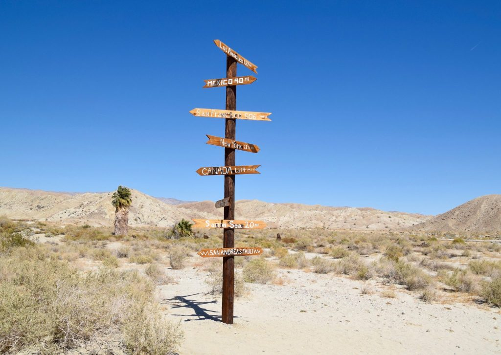 desert road sign to nowhere