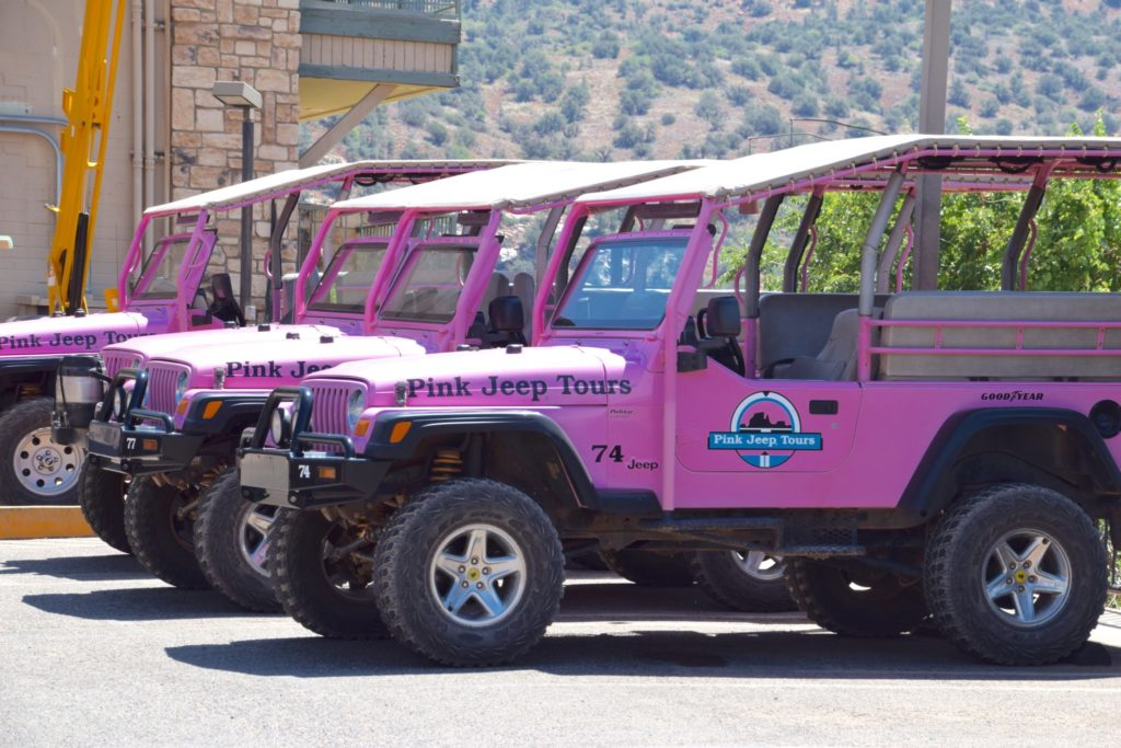 line of Pink Jeep Tours vehicles in Sedona Arizona