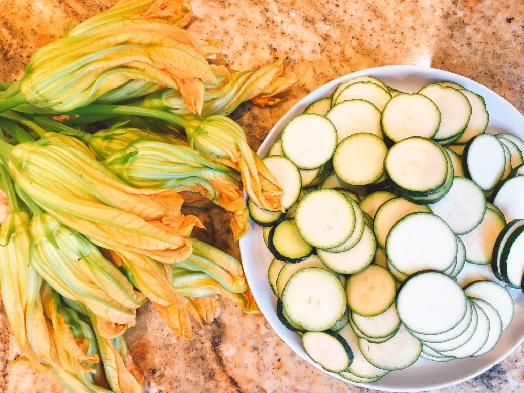 sliced zucchini rounds with flowers