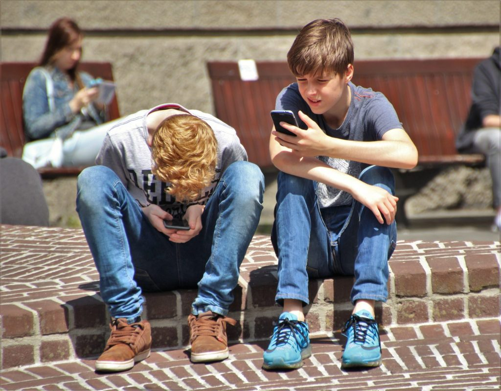 boys using cell phones