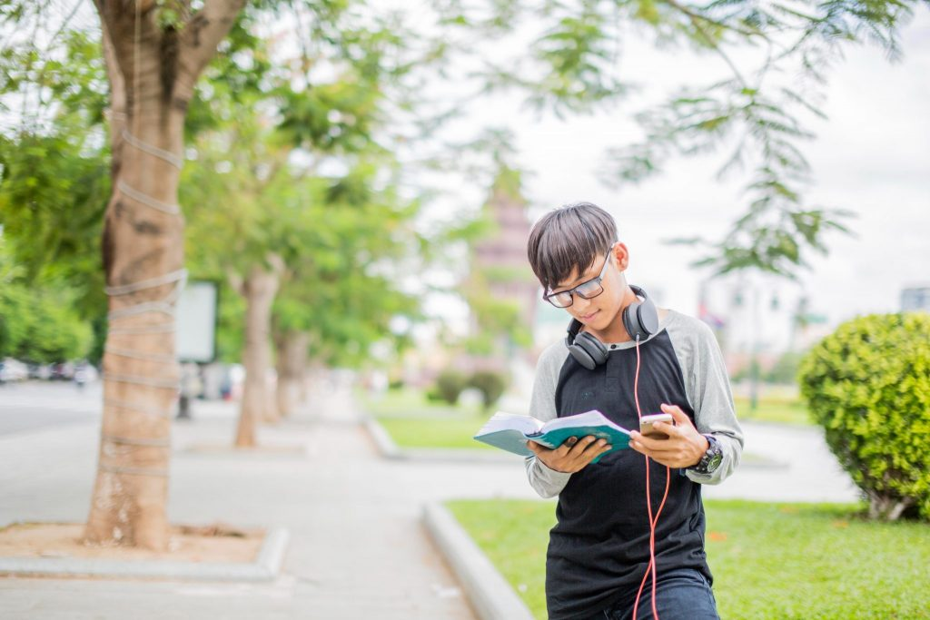 boy with book and headphones