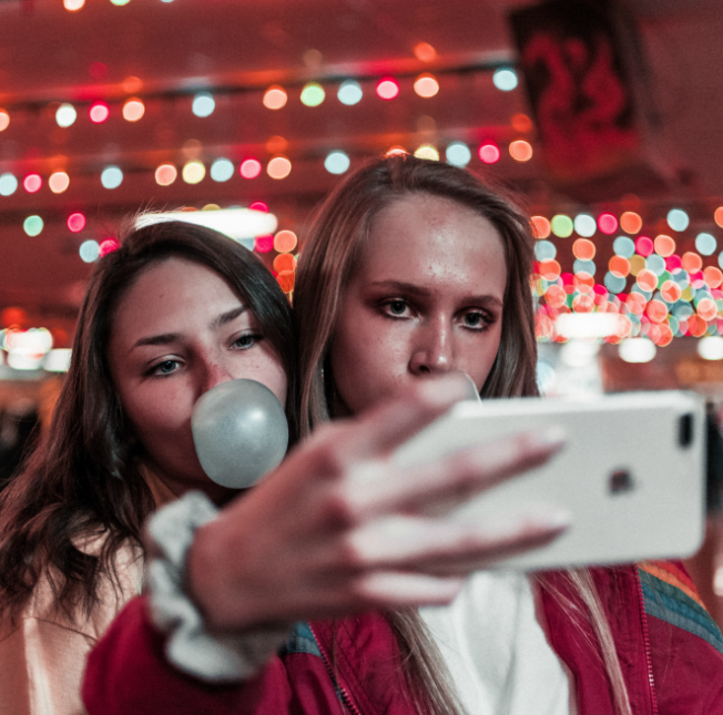 girls taking selfie