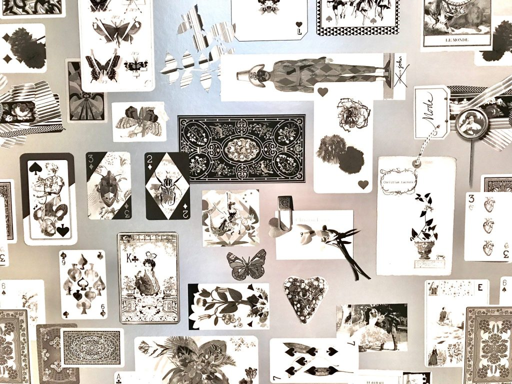 black and white wallpaper of playing cards and other items