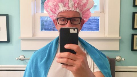 man with shower cap lice treatment