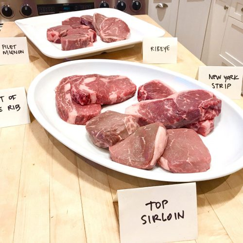 platters of different types of steak from Omaha Steaks