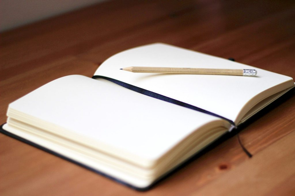 blank writing journal with pencil