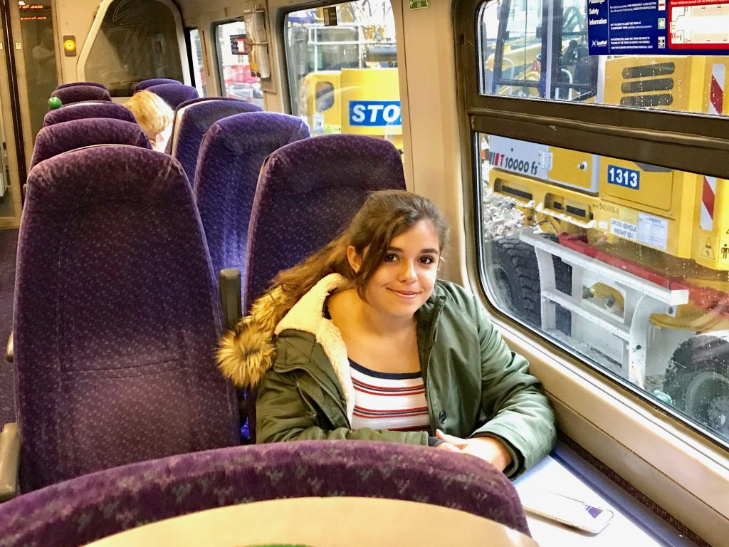 girl on ScotRail train in Edinburgh Waverly Station