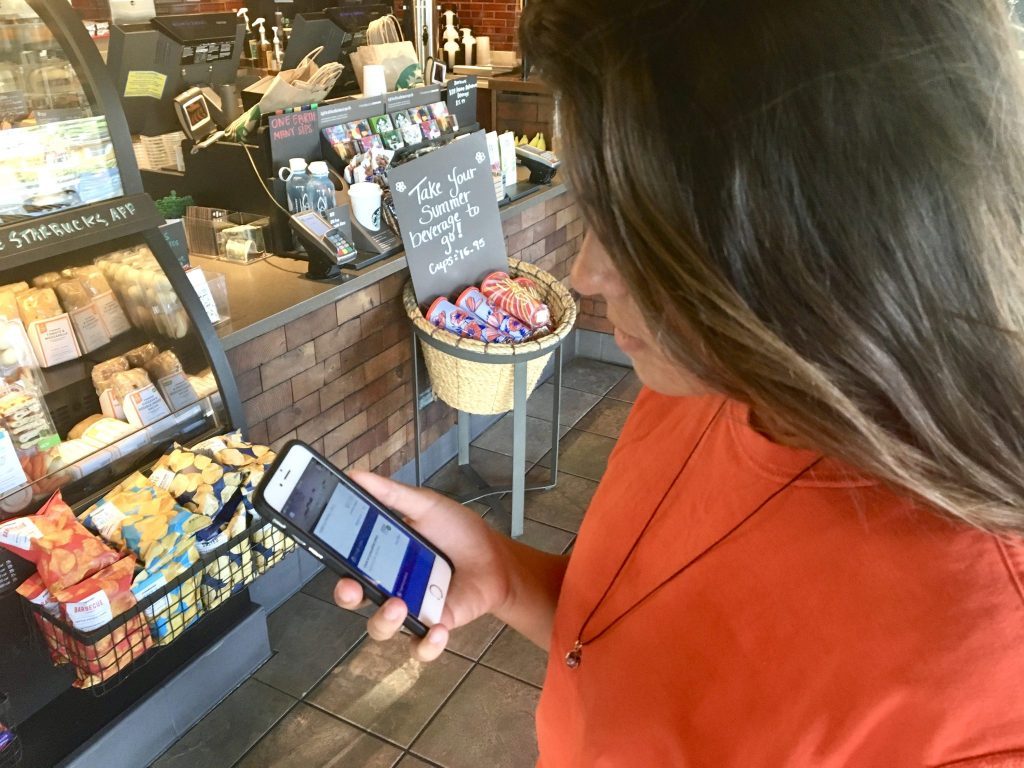 girl in Starbucks with app