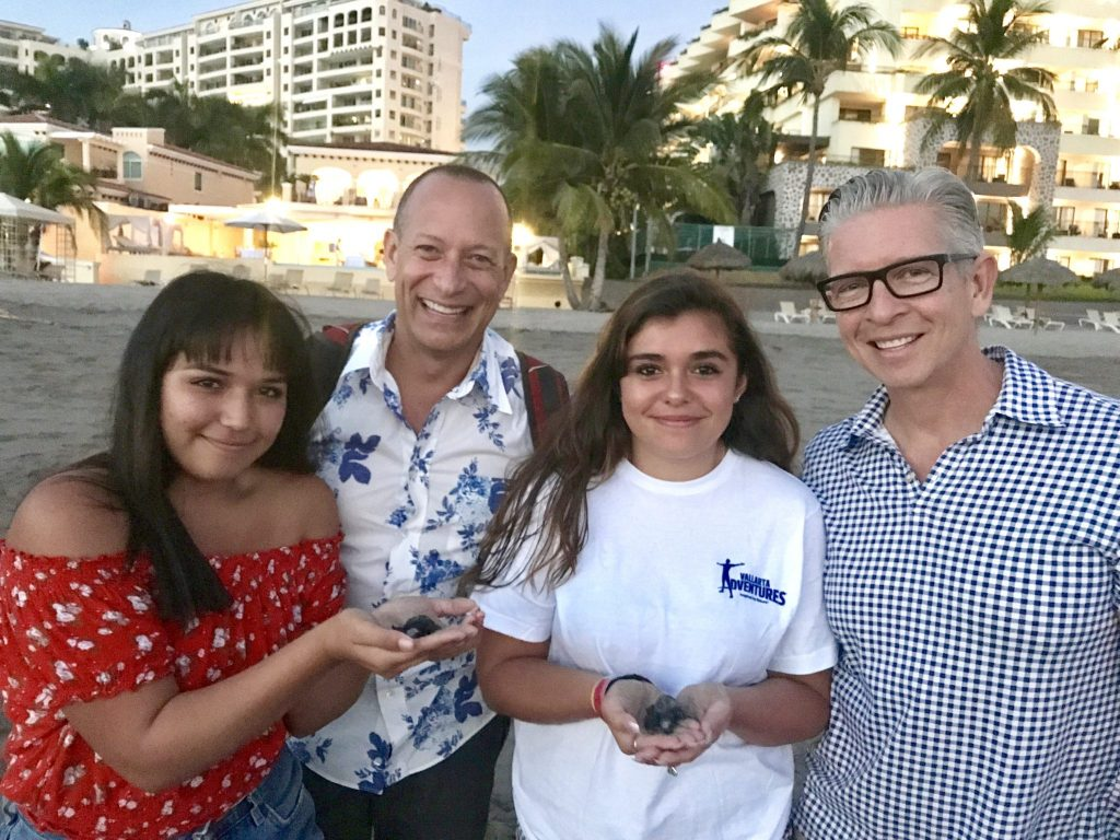 family at baby turtle release Marriott Puerto Vallarta