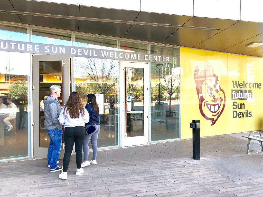 family entering Arizona State University Welcome Center