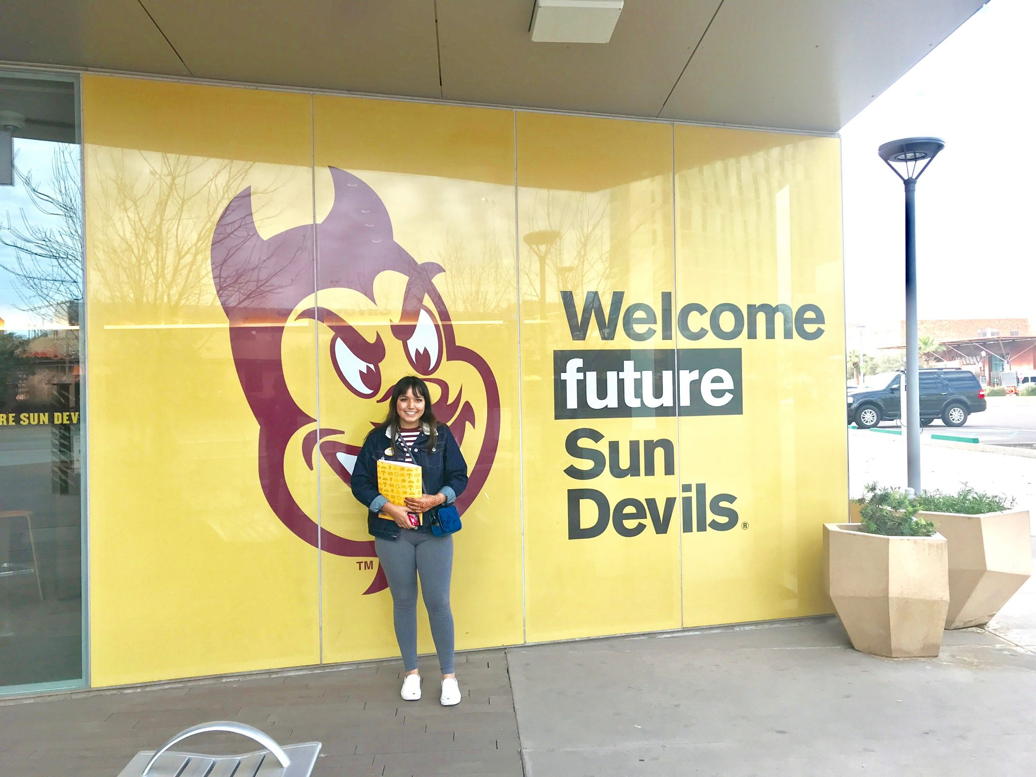 girl in front of Arizona State University Welcome Center