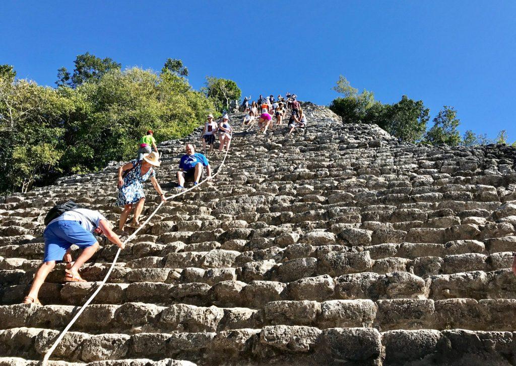 climbing Nohoch Mol Temple at Coba