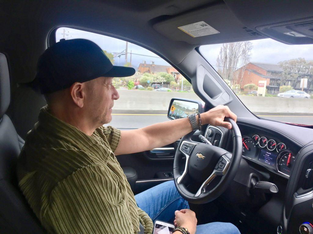 man behind wheel of Chevy Silverado