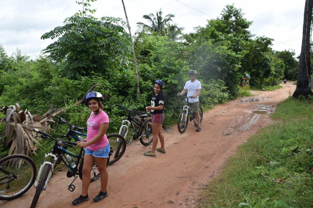riding bikes through the jungle in Cambodia