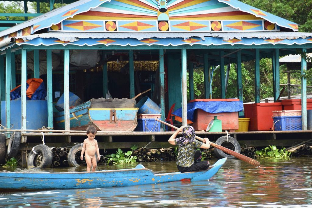 floating village family on Lake Tonle Sap, Cambodia