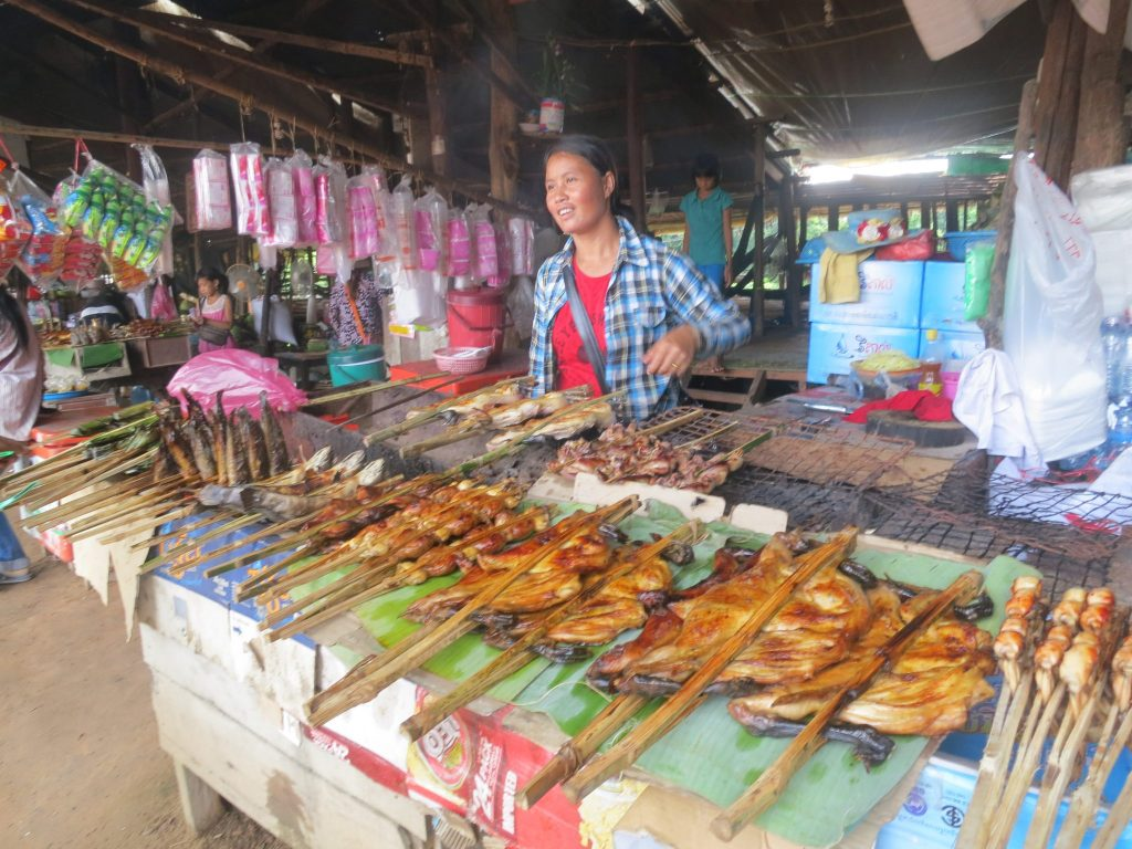 woman selling meat on sticks in Cambodian Market, Siem Reap