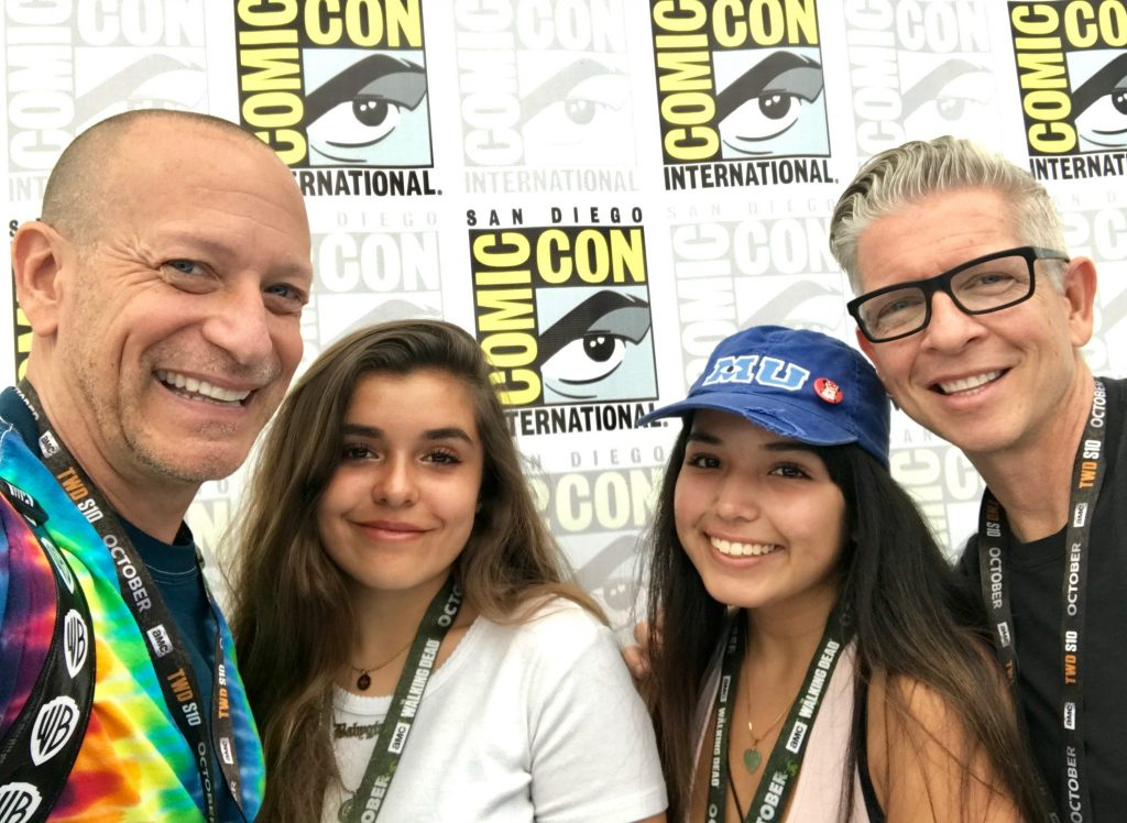2 Dad Family poses at Comic Con with logos