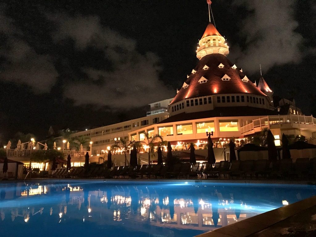 Night view of The Hotel Del Coronado tower and pool
