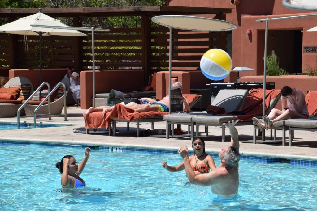 family playing in the pool at Enchantment Resort in Sedona, Arizona