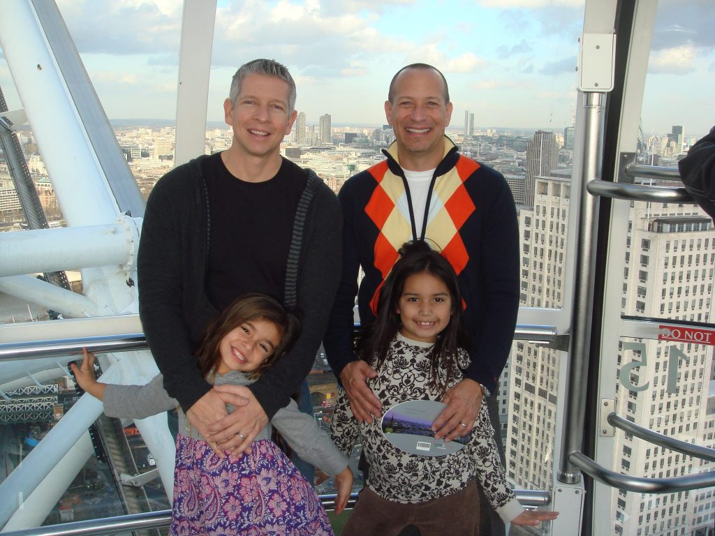 family with 2 dads on the London Eye in London, England