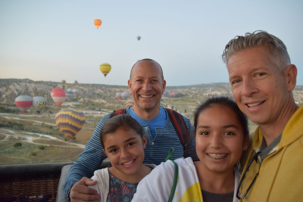 family with 2 dads in a hot air balloon in Cappadocia, Turkey
