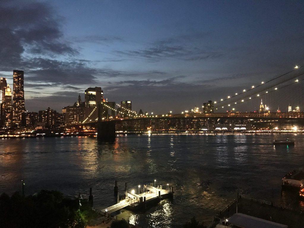 Brooklyn Bridge at night looking towards New York City