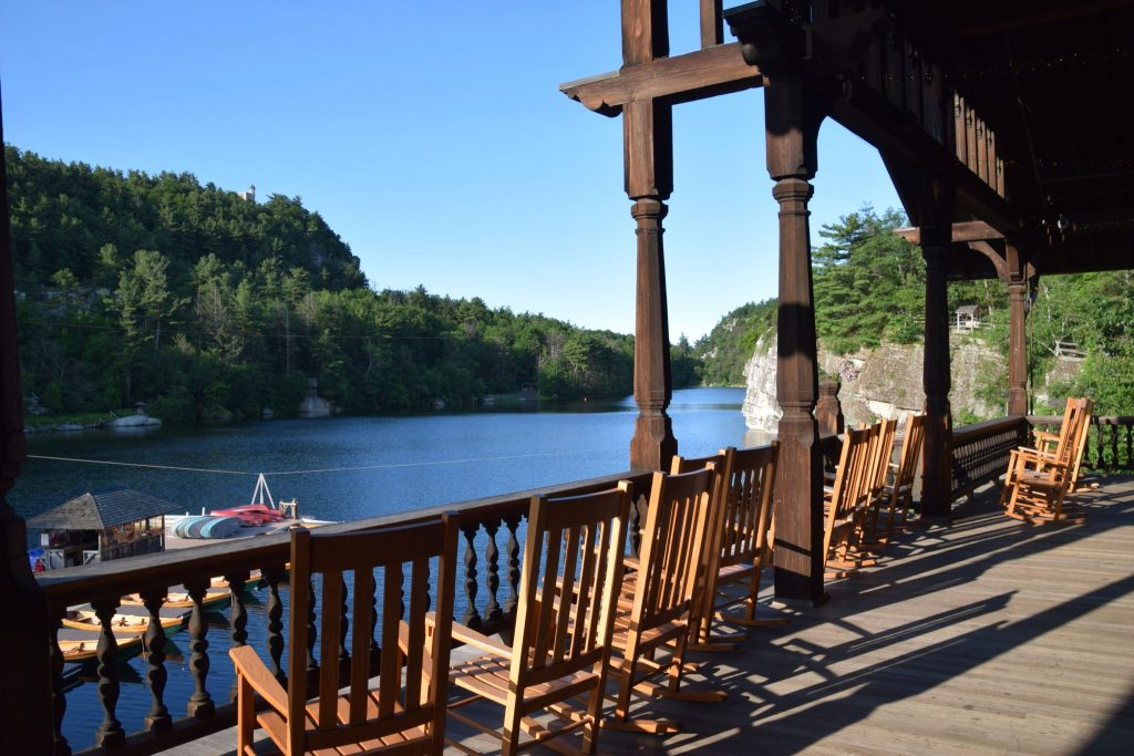 Mohonk Mountain House deck with rocking chairs overlooking Mohonk Lake