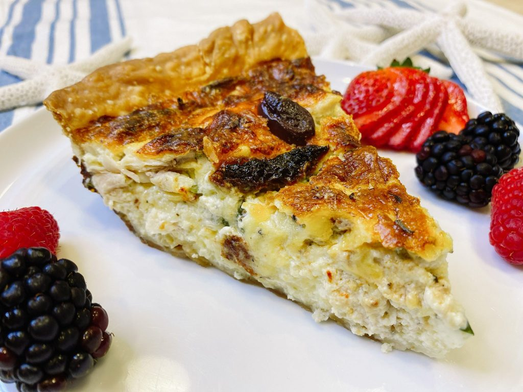 close up of chicken quiche slice with fruit