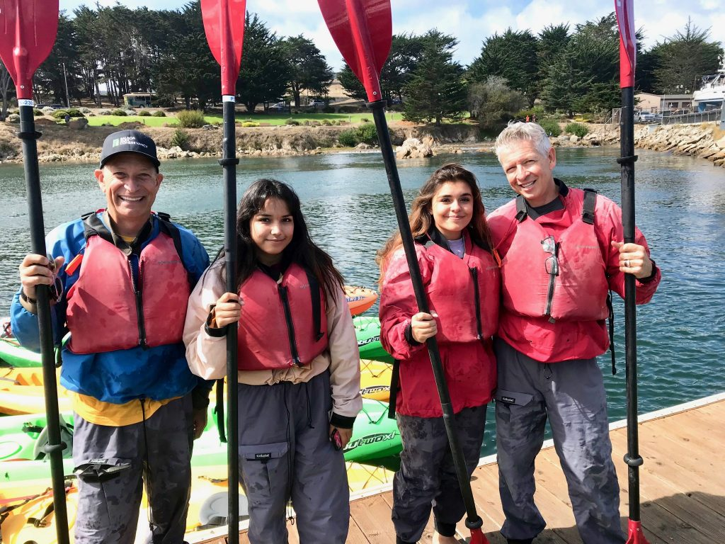 family with two dads kayaking in Monterey Bay near Cannery Row