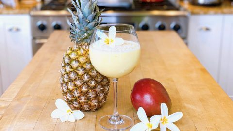 Mango Pineapple smoothie with fresh fruit and flowers