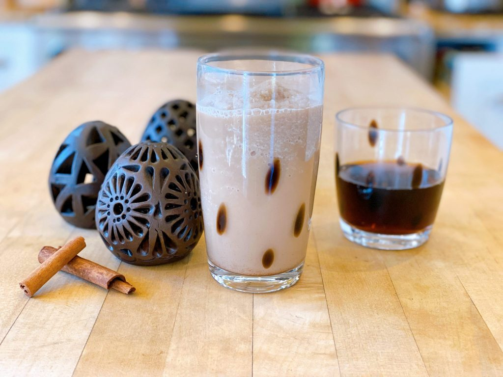Mexican Coffee smoothie with cinnamon sticks.
