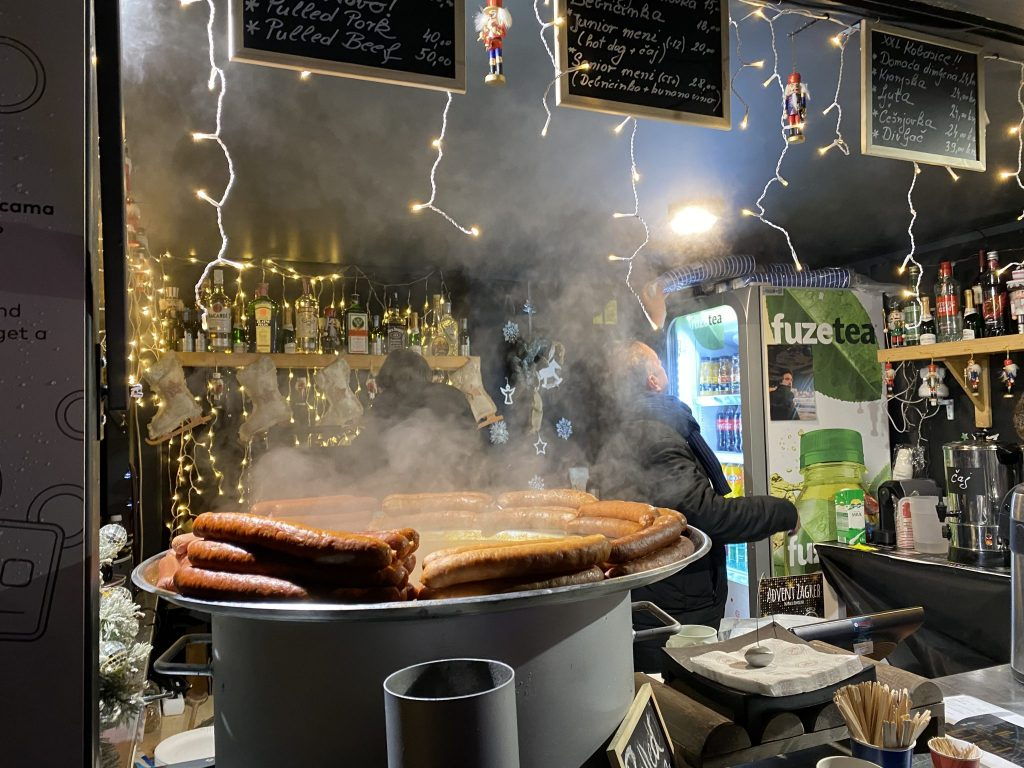 Food stand at Zagreb Advent Market selling locally made sausages