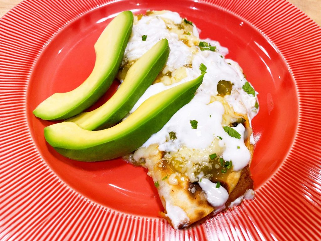 Serving of Cheesy Baked Quesadilla with Green Tomatillo Salsa