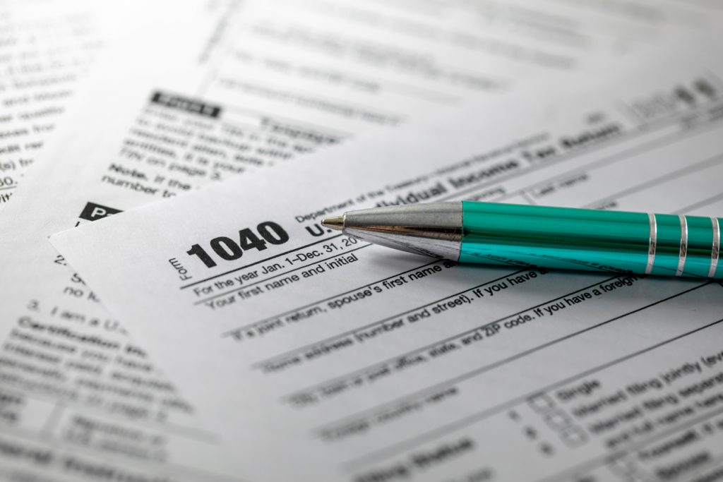 annual tax form 1040 and pen
