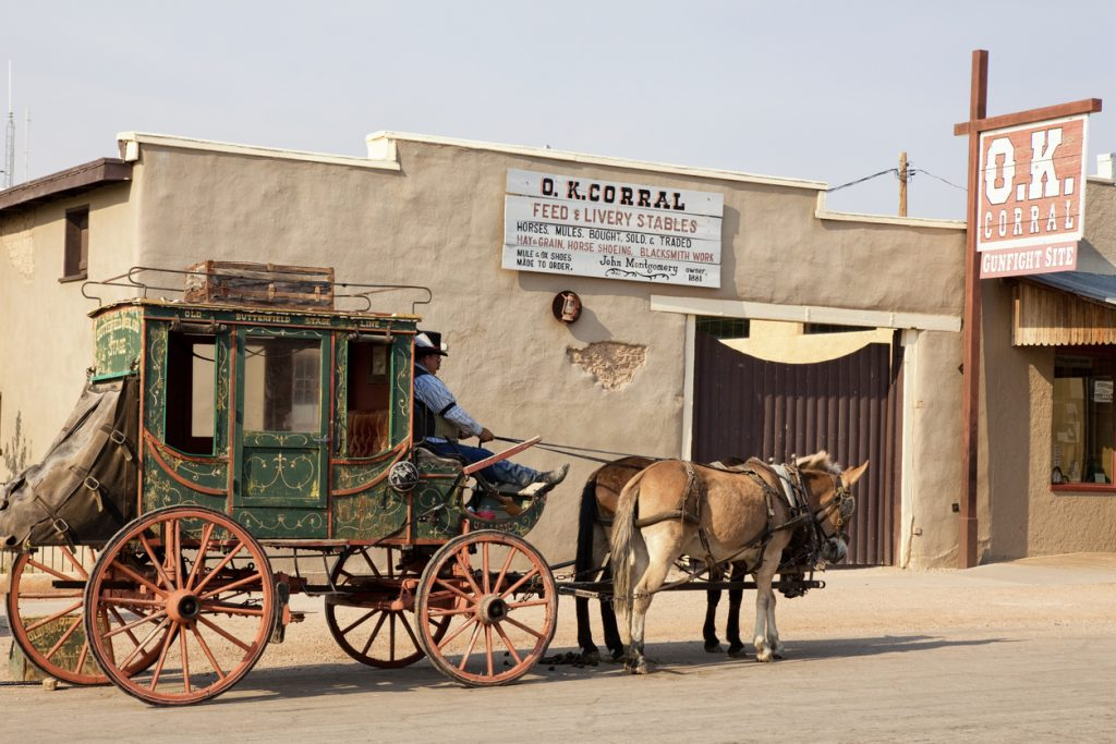 Tombstone, Arizona, United States - May 31, 2012. Stagecoach in front of the O.K. Corral on Allen Street in Tombstone, AZ. This is the famous location of the gunfight between the Earp brothers and a group of various outlaws.