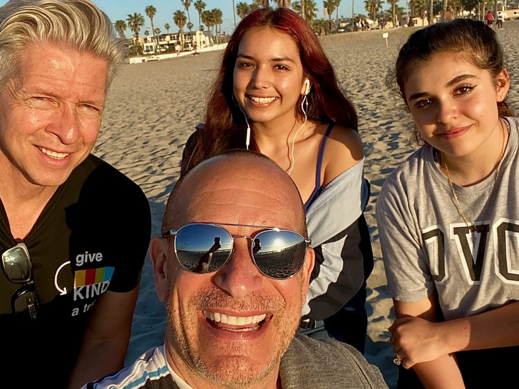 family with two dads at beach in Southern California