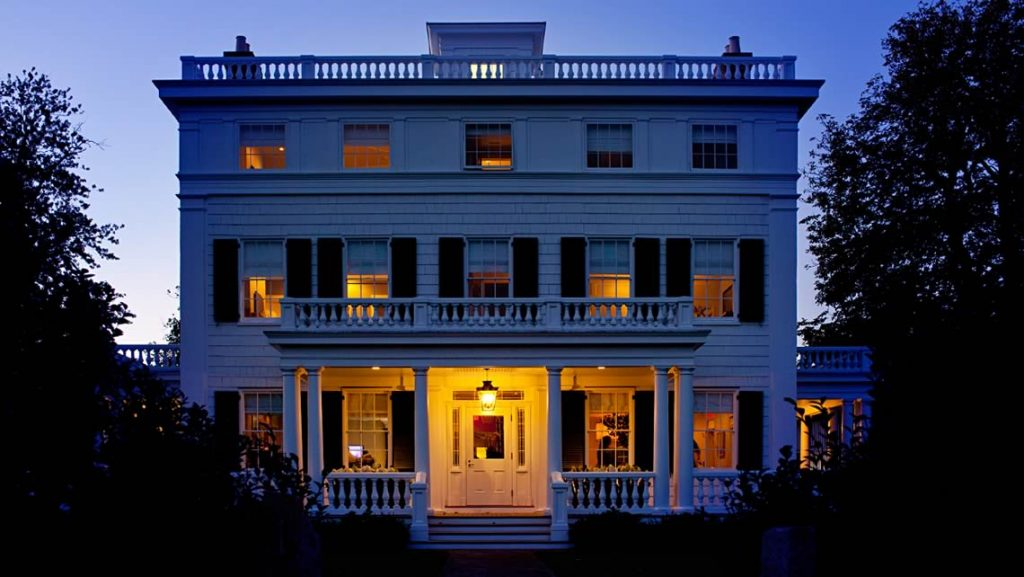 At dusk the Topping Rose House in Bridge Hampton, NY looks stately