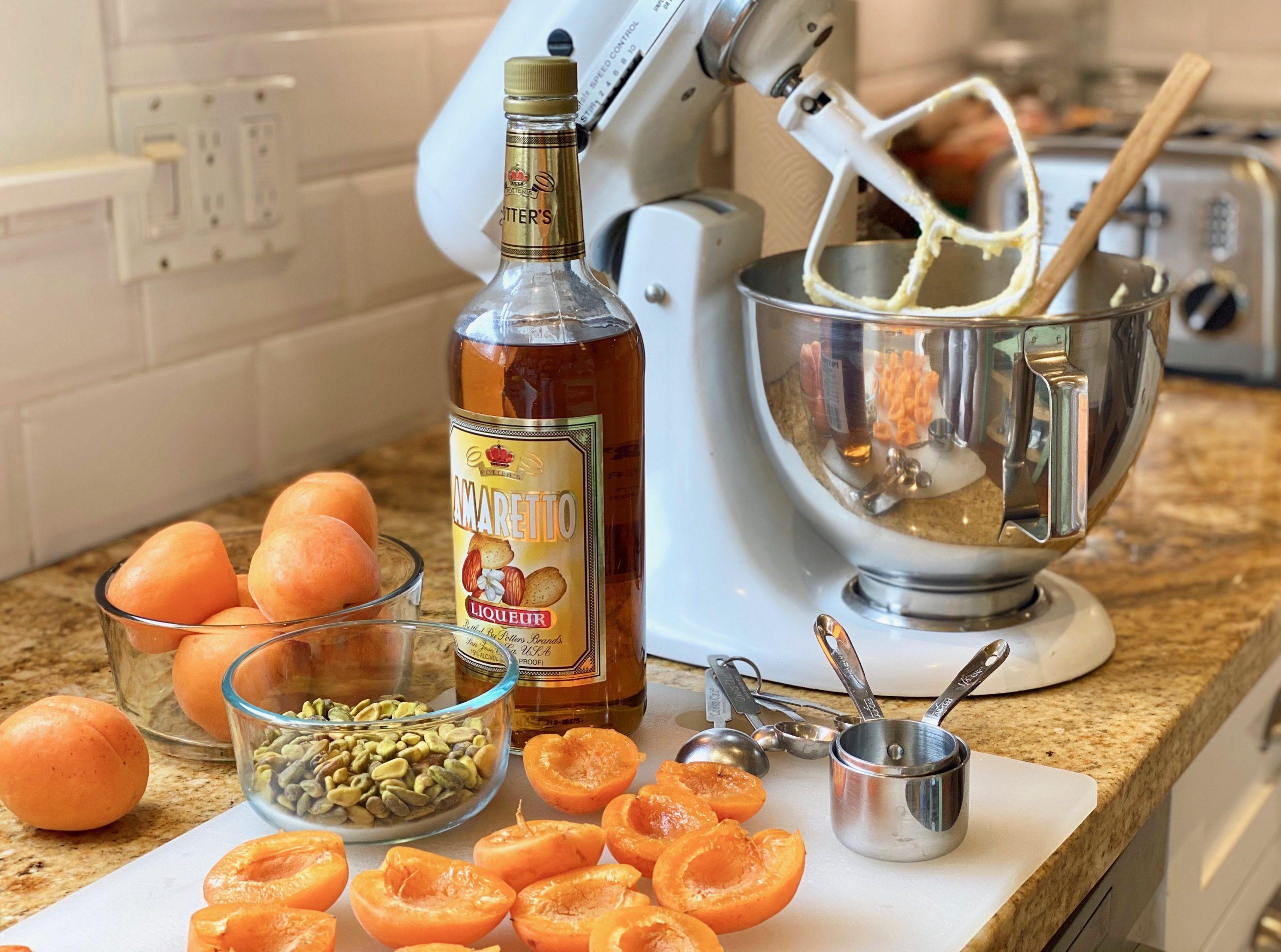 Amaretto liqueur with apricots, pistachio nuts and a kitchen mixer.