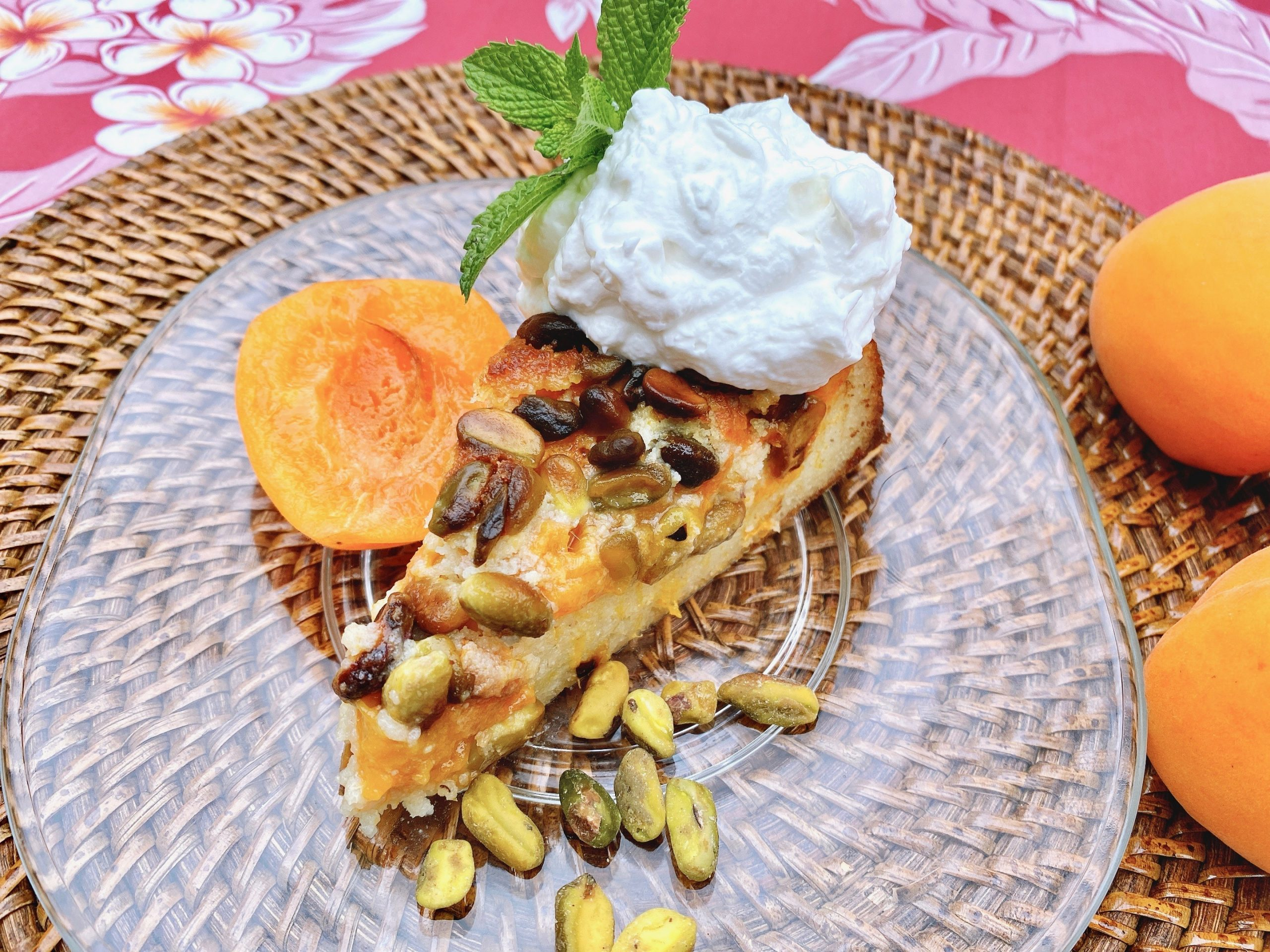 Slice of Apricot Pistachio Cake with Amaretto and a dollop of whipped cream.
