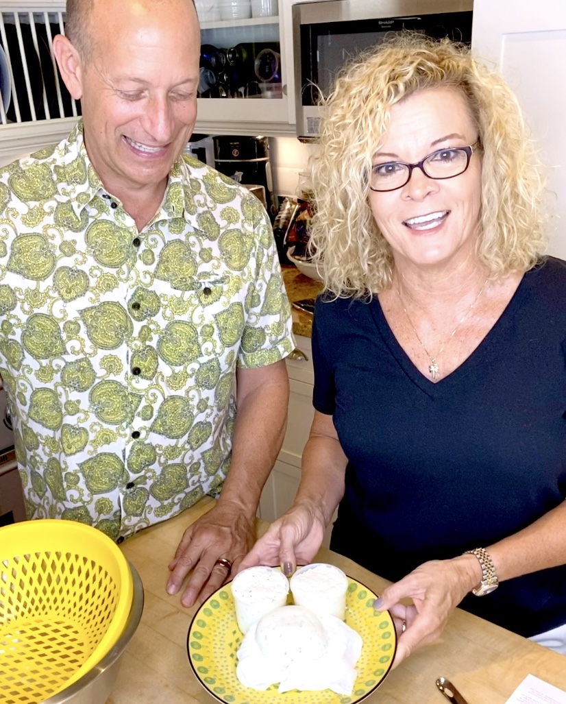 Man and woman show their homemade goat cheese