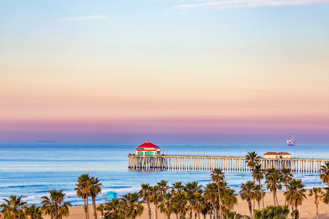 Sunrise sky over Huntington Beach Pier and the Pacific Ocean in Huntington Beach, California.