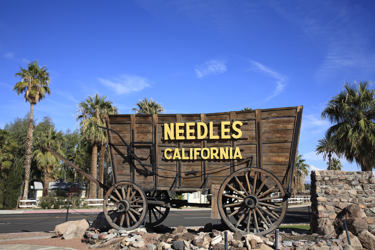 Old wagon with signage at entrance to Needles California. Historic and still somewhat vibrant town on Route 66.