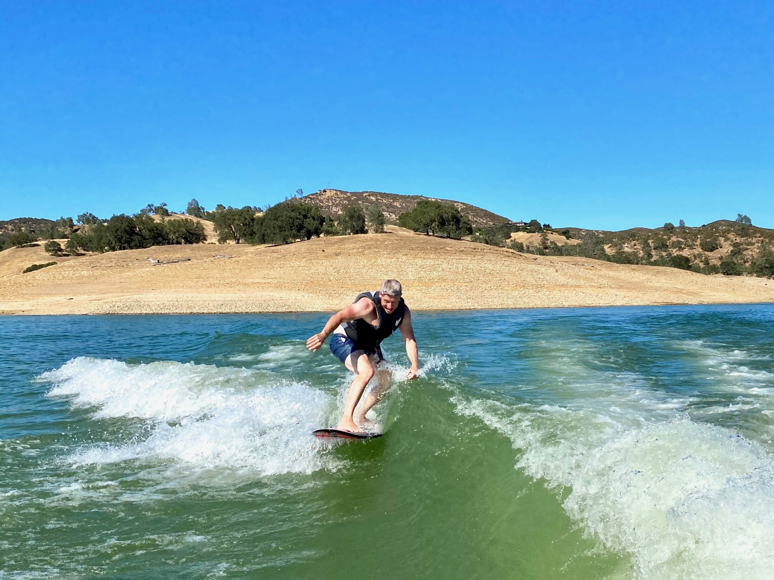 Man wake surfing at Lake Nacimiento, CA