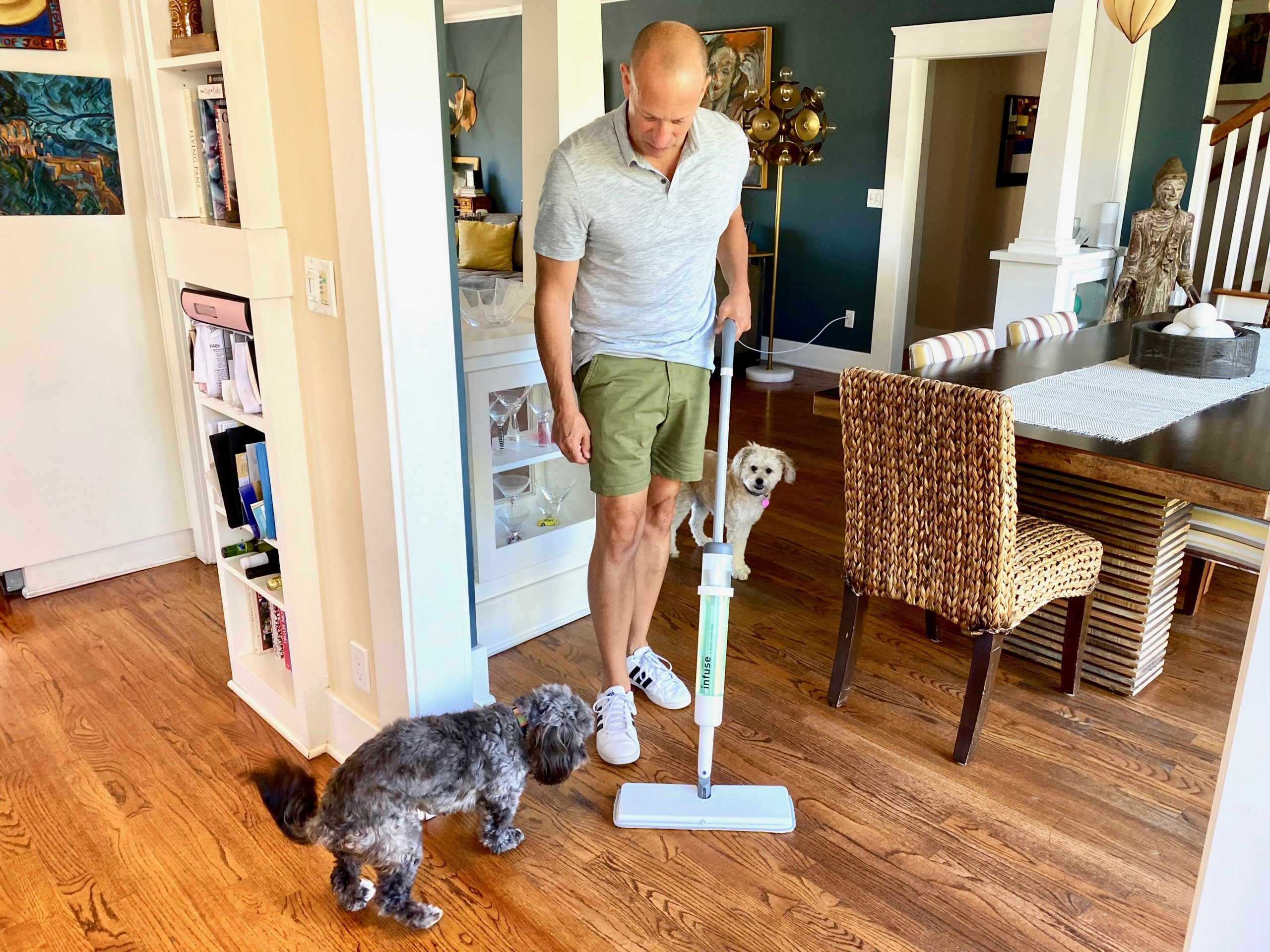man cleans wood floors using Infuse Cleaning System mop