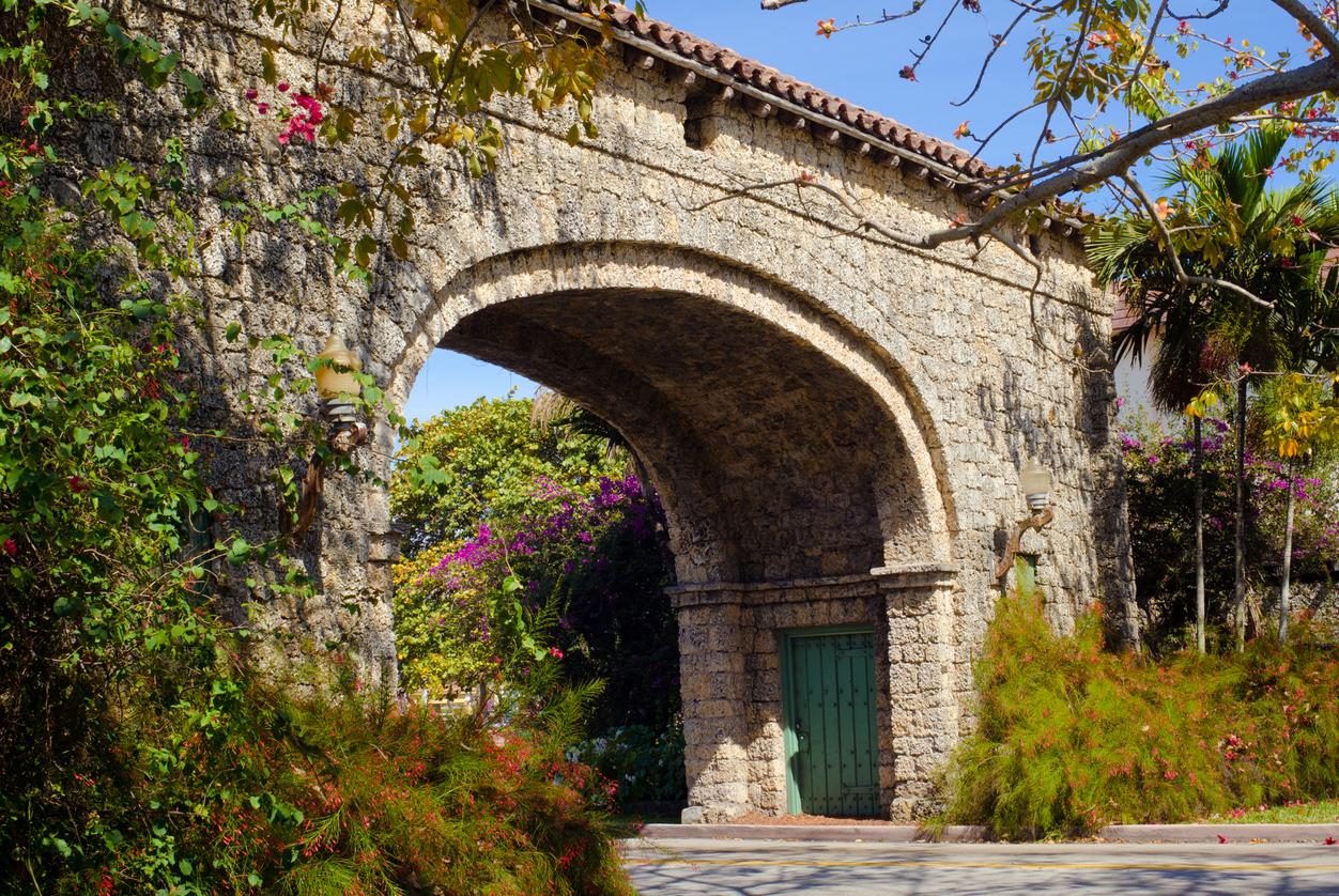"""""""Granada Entrance featuring a stone arch over Granada Blvd in Coral Gables, FL."""""""