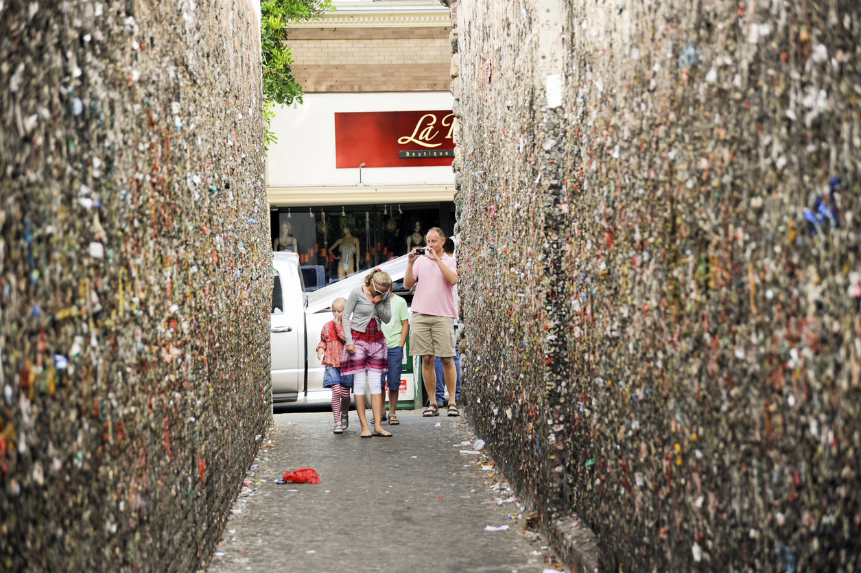 A family of tourists begins their walk through Bubblegum Alley a famous landmark in the city of San Luis Obispo