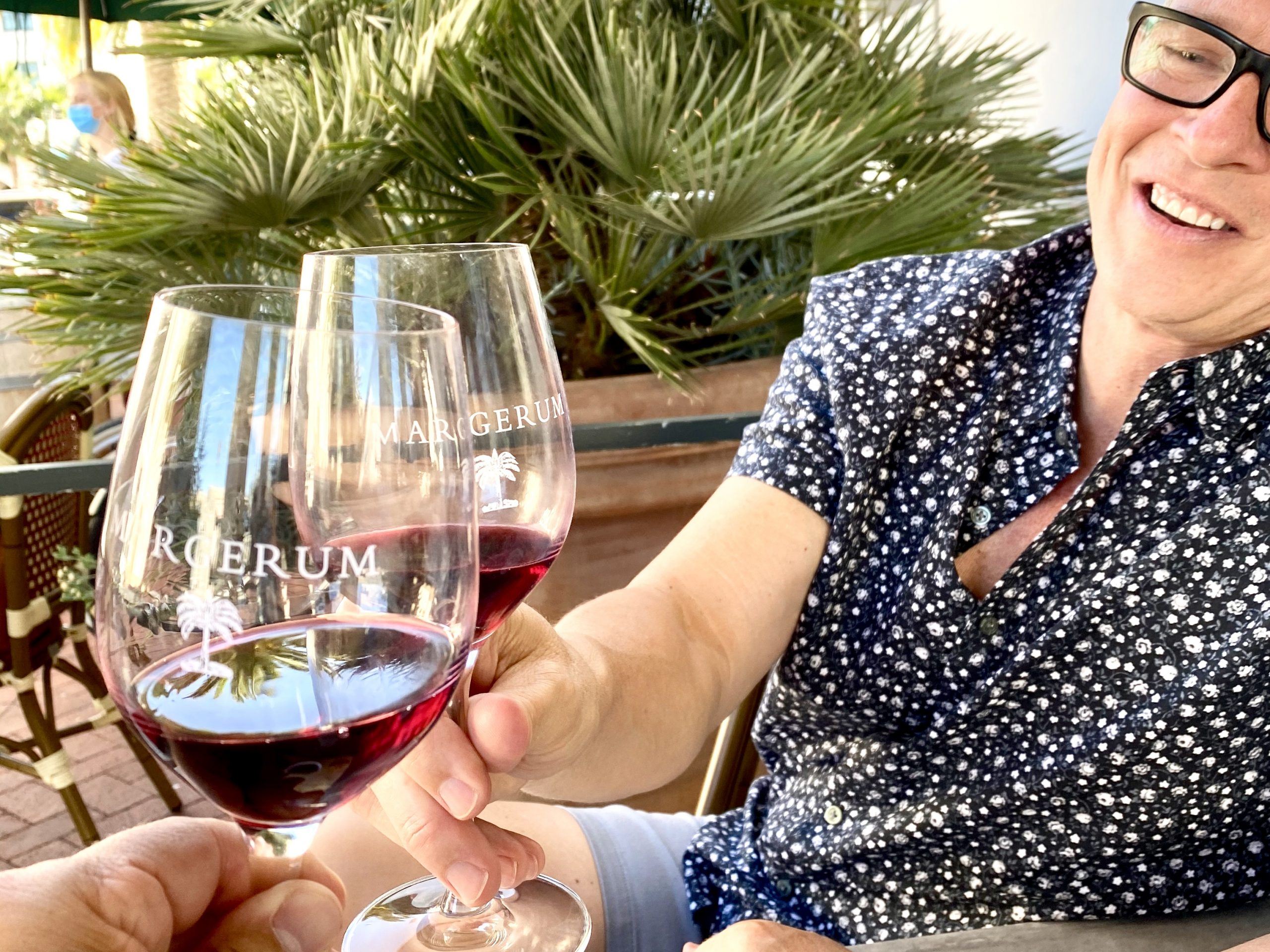 toasting wine glasses at Margerum Winery tasting room in Santa Barbara, CA