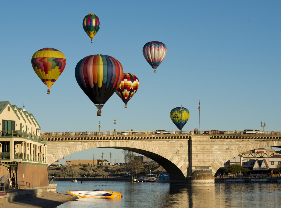Lake Havasu City, USA - January 20, 2013 - Six hot air balloons in flight over the London Bridge in Lake Havasu City participating in the Lake Havasu Balloon Fest.