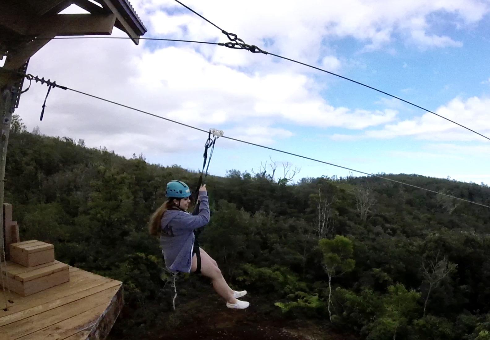 girl on zipline with Kapohokine Adventures near Hilo, Hawaii